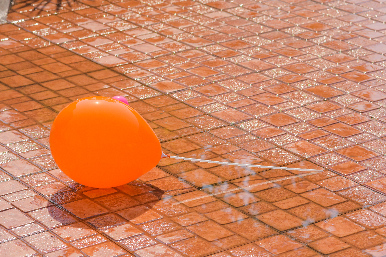 Balloons on paving stones on sidewalks.